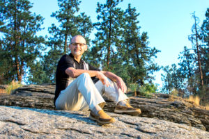 man sitting on rock